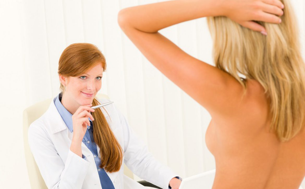Plastic surgery female doctor look patient breast